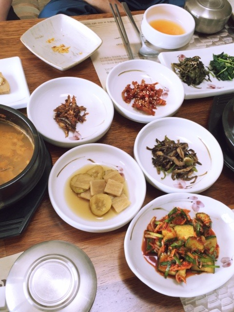 A table bent with the weight of food – Korean side dish culture