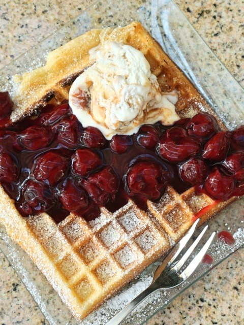 Waffles with hot cherries in a sun-filled conservatory, Schloßcafé